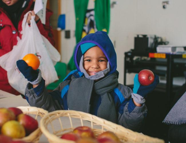 Happy Child Receiving Food